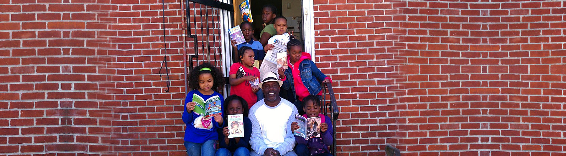 Mr. ashby with students holding book