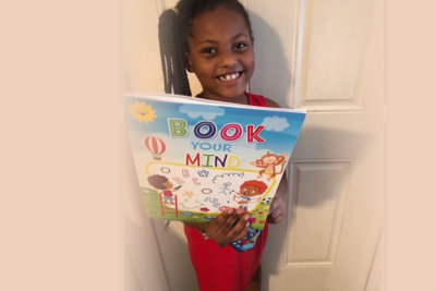children having book lessons outdoors